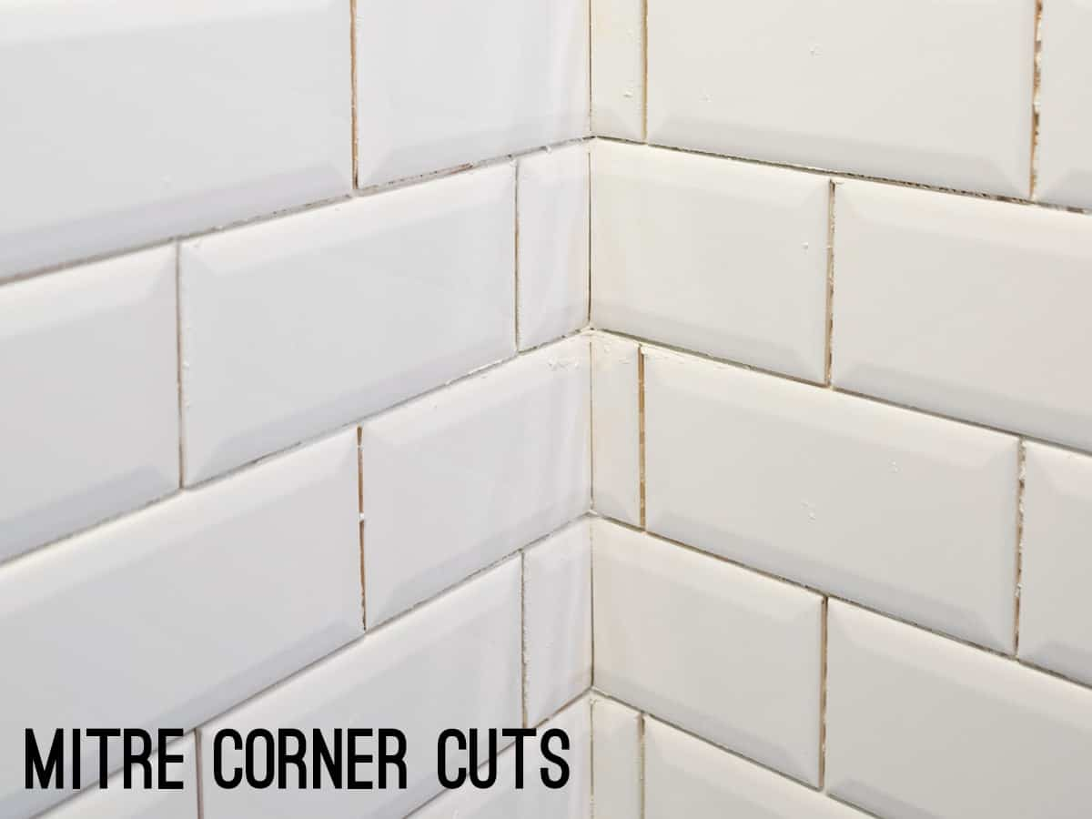 Mitre cuts in corners of white subway tiles