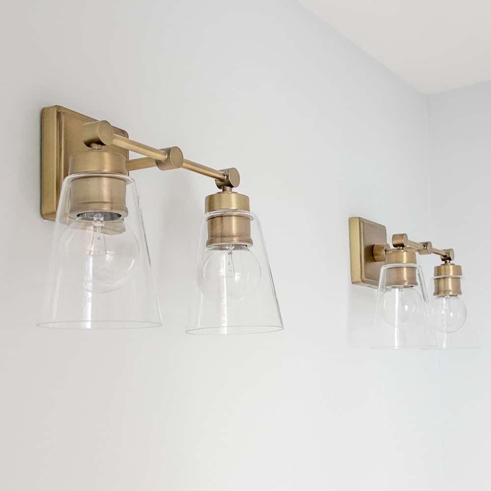 Vintage Modern styled dual vanity lights in aged brass for classic modern guest bathroom