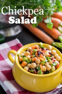 Delicious Summer Chickpea Salad - A delicious chopped salad with lots of veggies, cranberries, and a tangy vinaigrette dressing