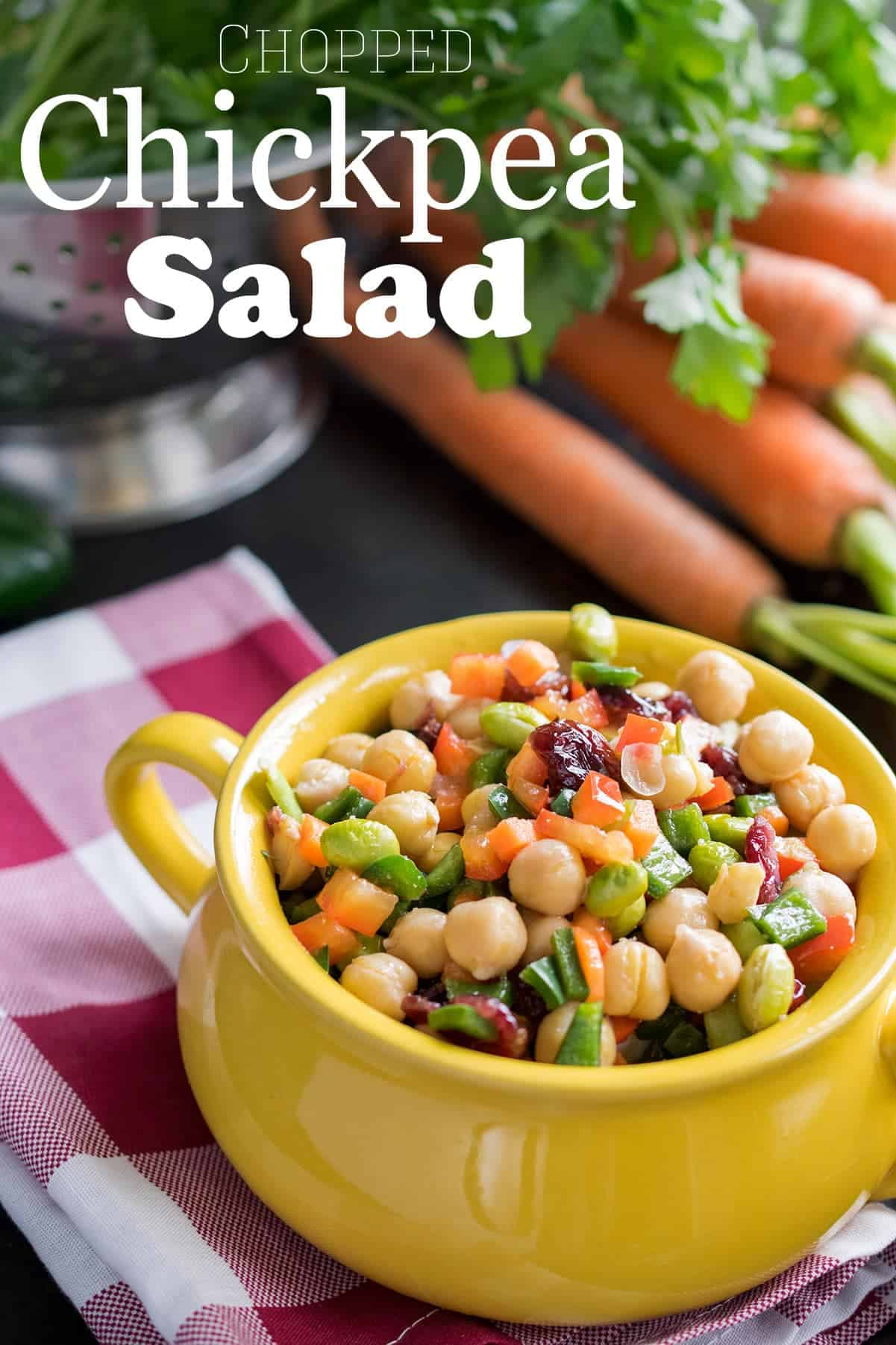 Chickpea Salad - diced fresh veggies, cranberries, chickpeas, & vinaigrette served in small yellow crock.