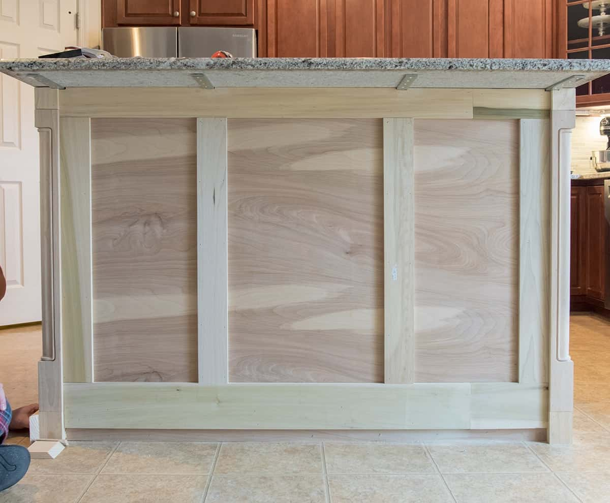 Added baseboards and trim boards to kitchen island