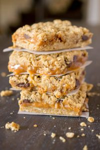 The Best Caramel Chocolate Chip Cookie Bars! This carmelitas recipe is divine with layers of chocolate and caramel sandwhiched between two oatmeal layers