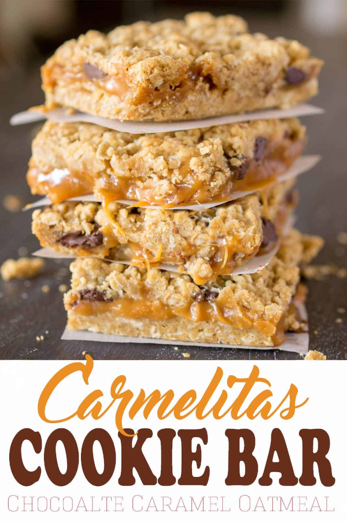 Baked Carmelitas Cookie Bars stacked on wax paper with post title