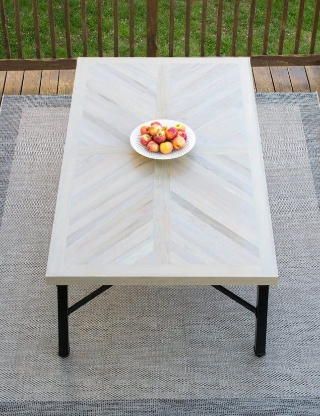 Wood farmhouse table in X cross pattern with black legs.