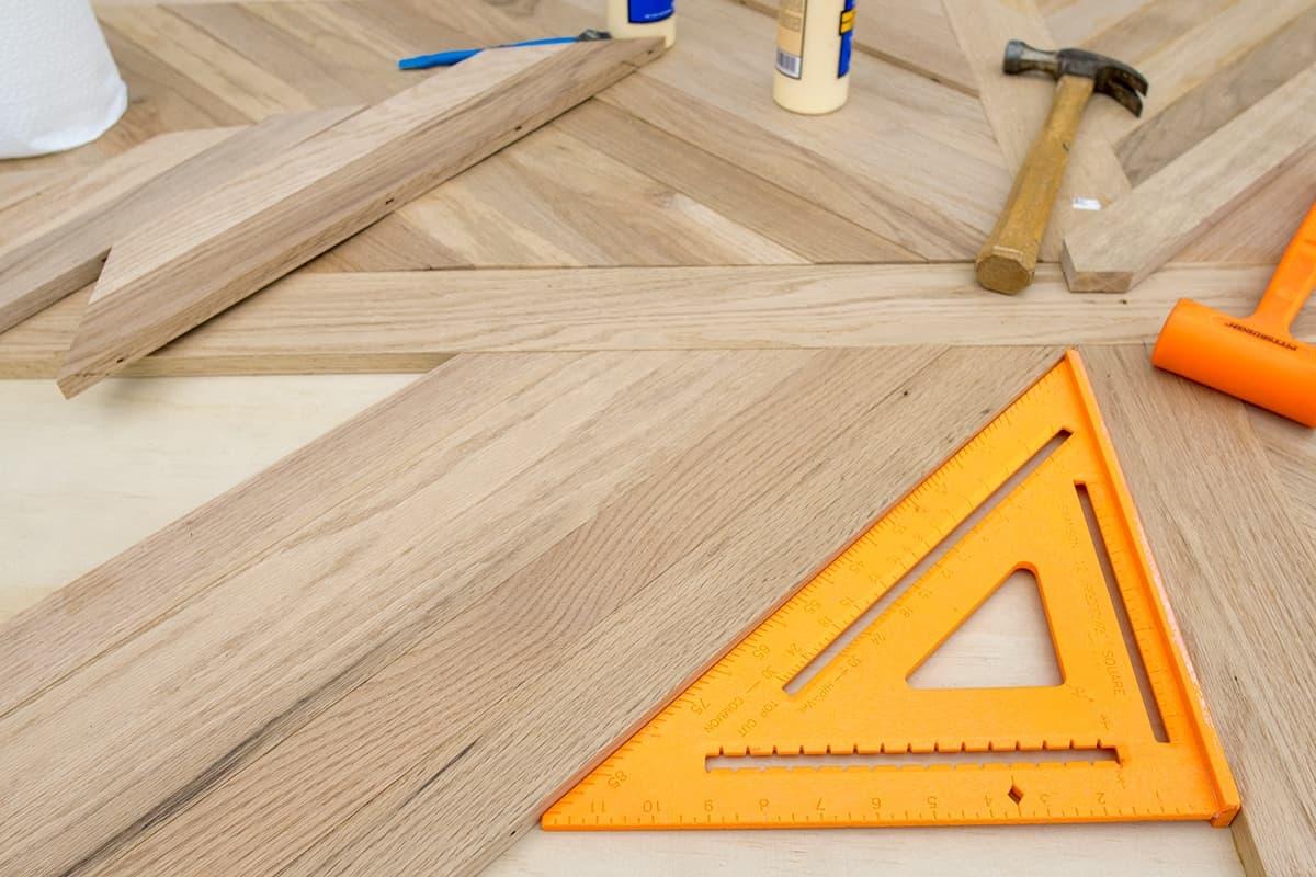 Reclaimed wood cross-X patterned patio table top using white oak hardwood.