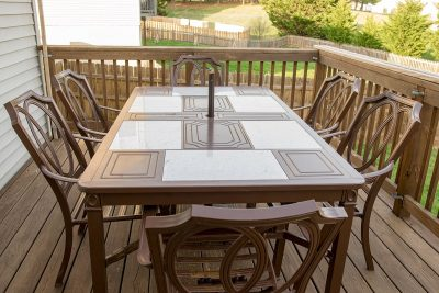 Brown outdoor dining table with 6 chairs.