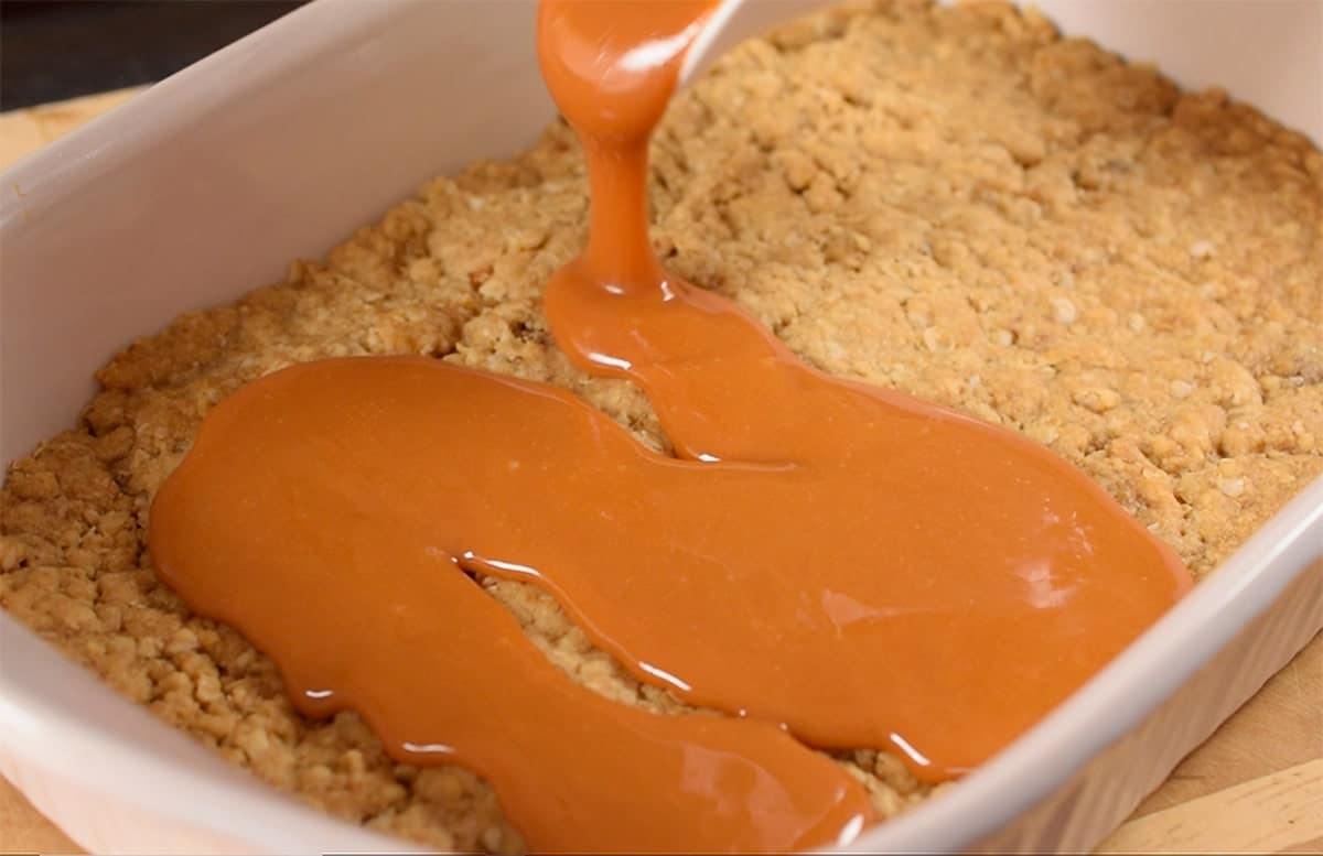 Melted caramel poured over Oatmeal base for Caramalitas