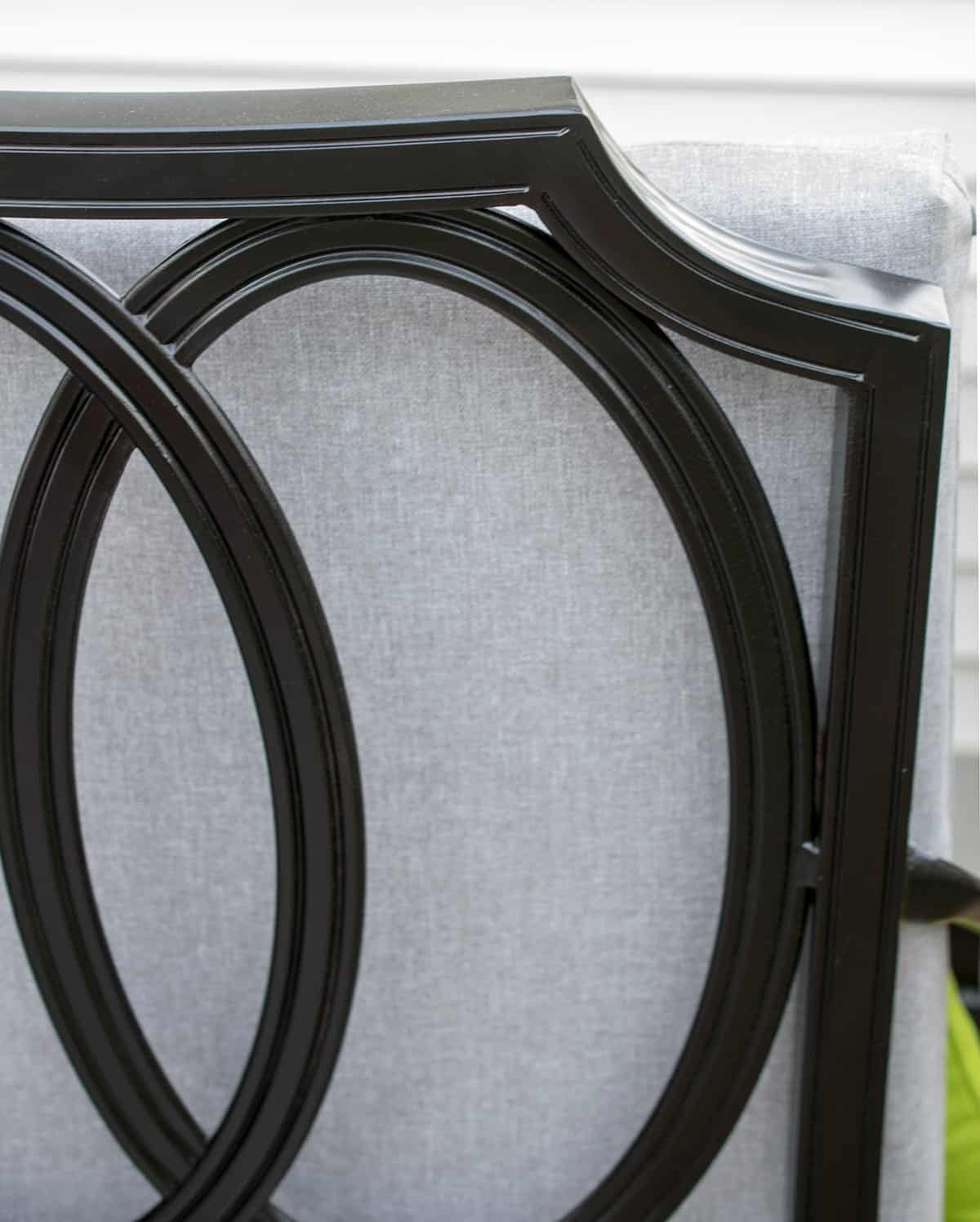 Refinished black patio chair detail show up close.