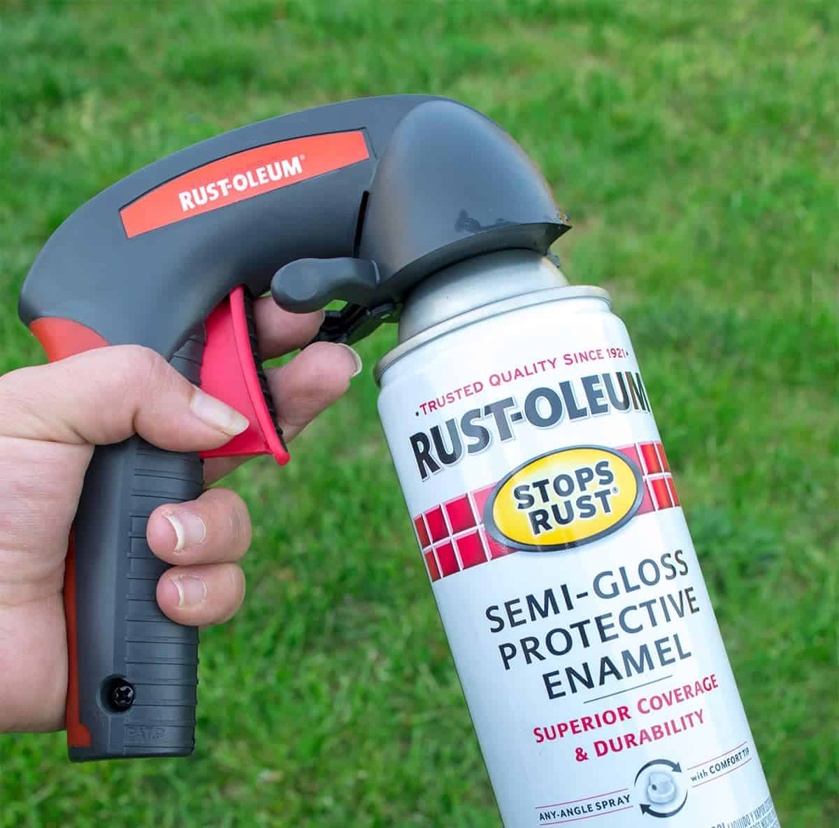 Can of rustoleum spray paint with comfort grip hand holder attached.
