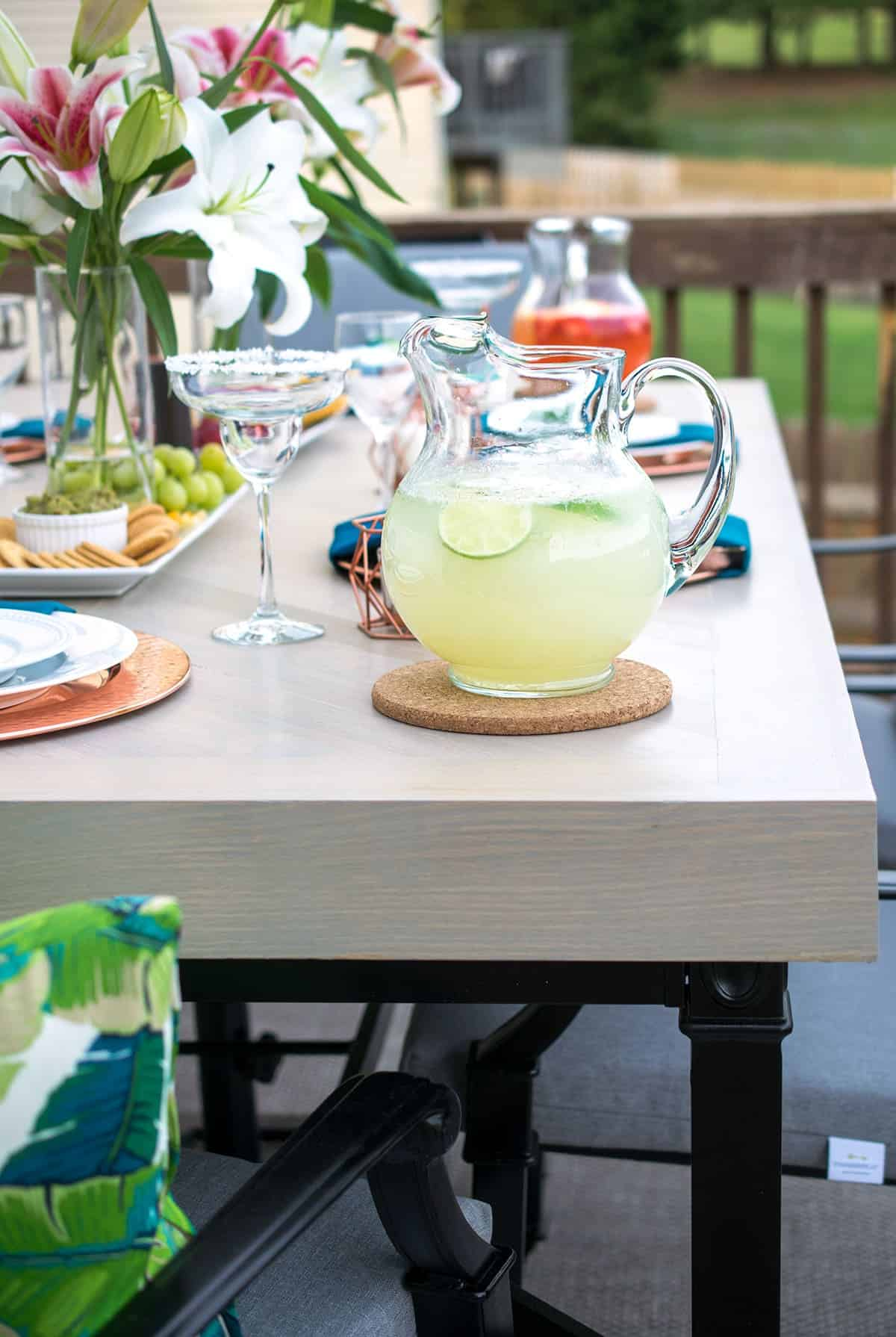 Refinished outdoor patio table and chairs with elegant tropical table settings.