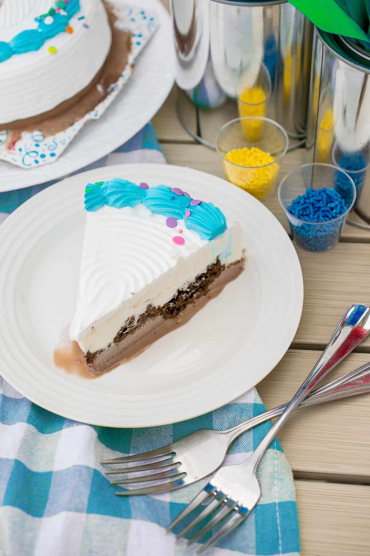 Ice cream cake on white plate with colorful sprinkles for individualized cake decorating