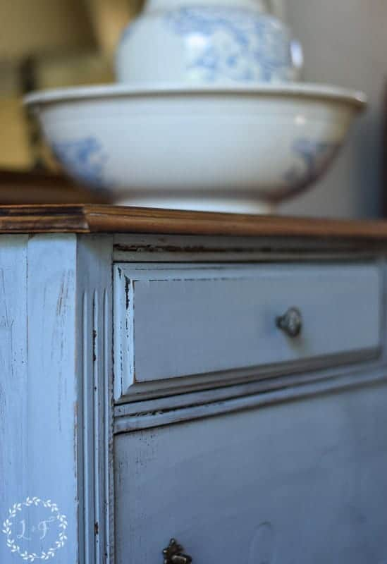 Distressed dresser painted with Miss Mustard Seed in Shutter Gray Color.