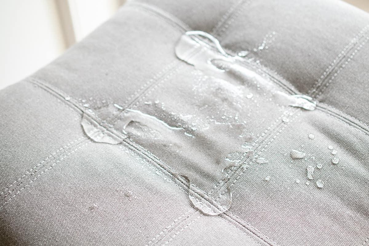 Waterproofing fabric - water beading on gray bar stool fabric