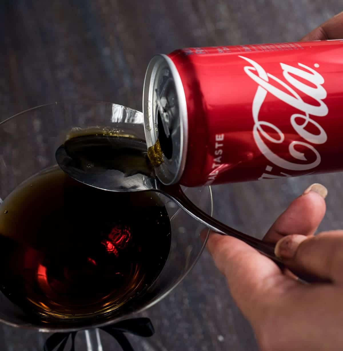 Layering Coca-Cola into martini with back of a spoon