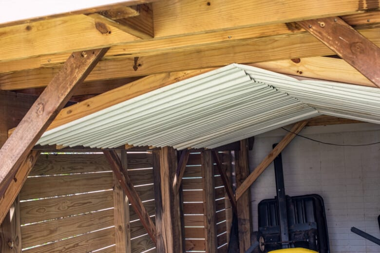Ceiling under deck with knee braces to keep rain out.