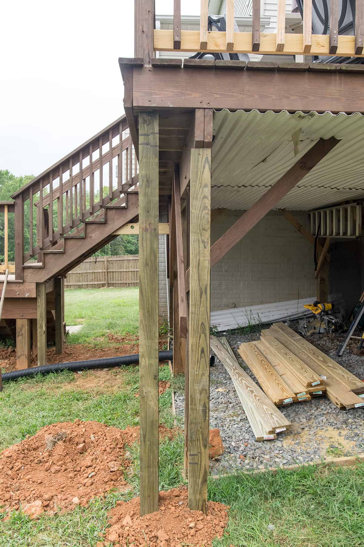 Progression of framing a deck to create a storage enclosure underneath.