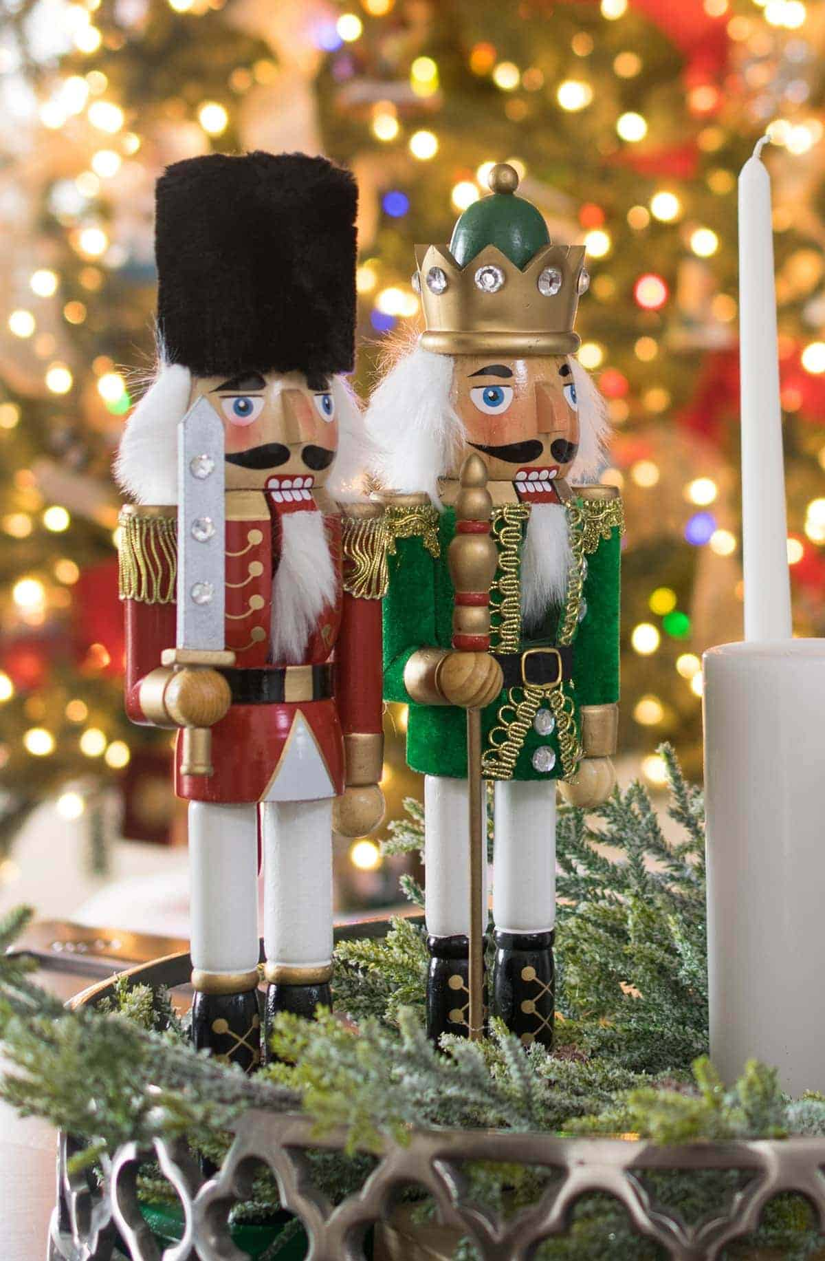 Nutcracker and candle sticks with greenery coffee table centerpiece.