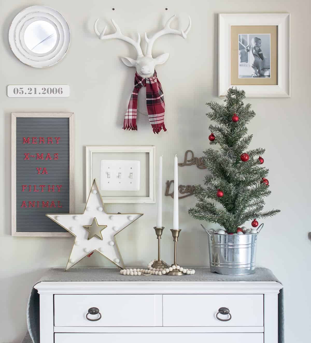 Christmas themed wall decor with red, white, and green color scheme.