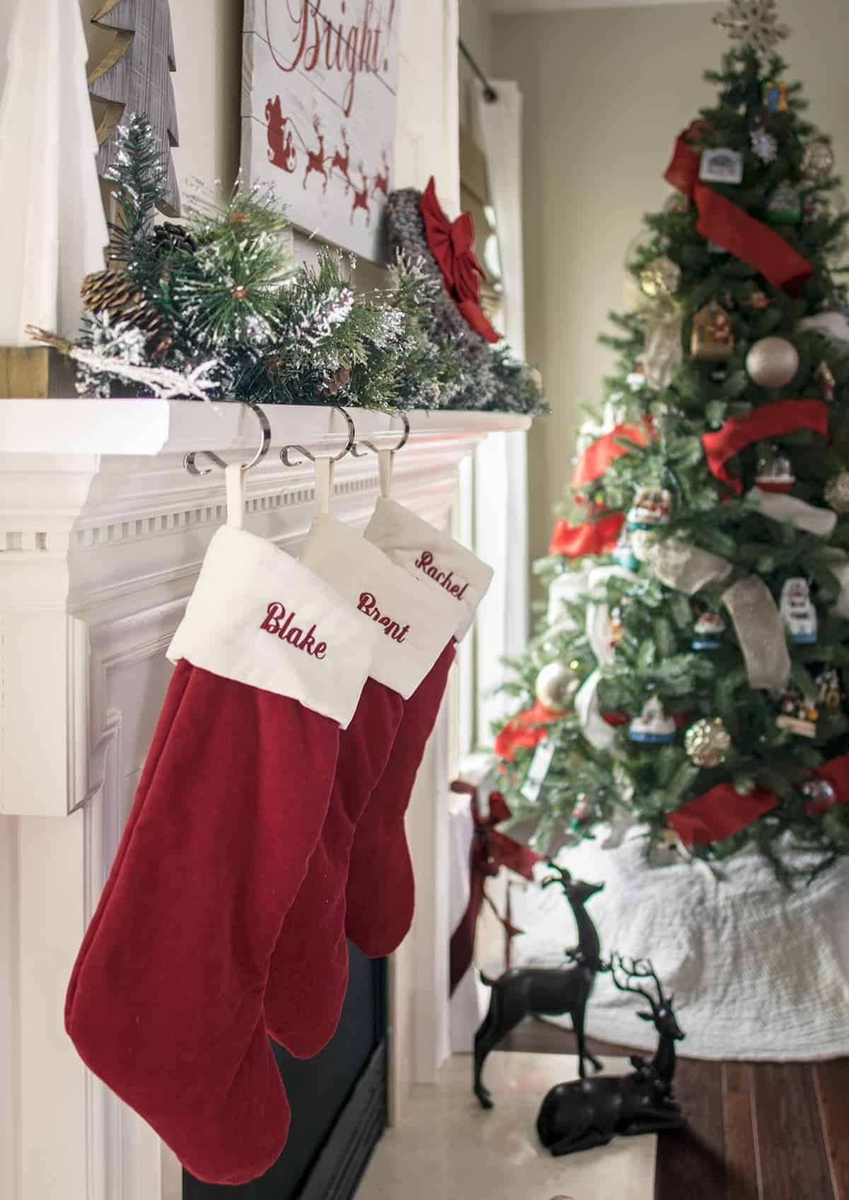 Traditional red christmas stockings hanging from the mantle