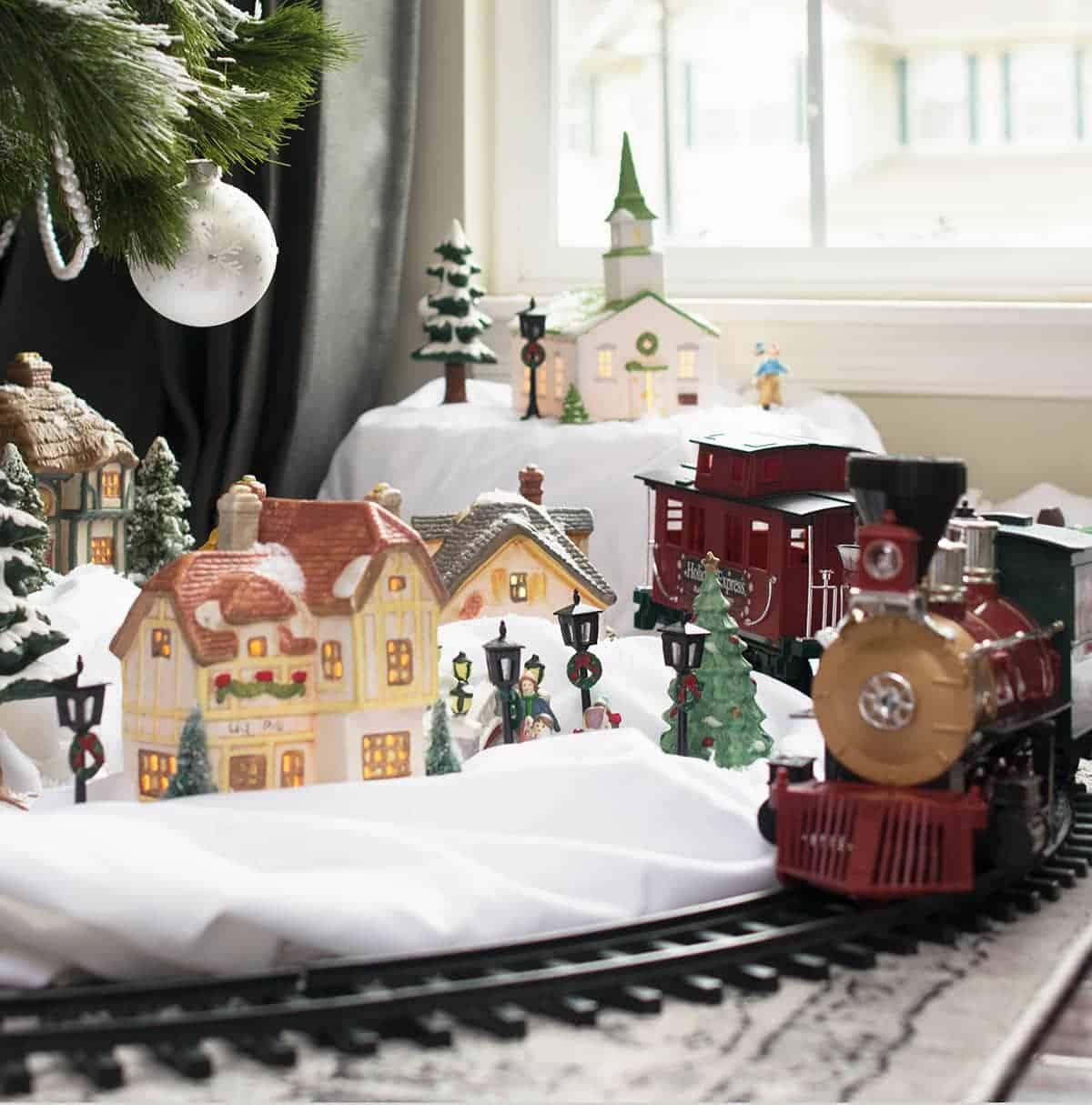 Vintage Christmas village set with antique train.