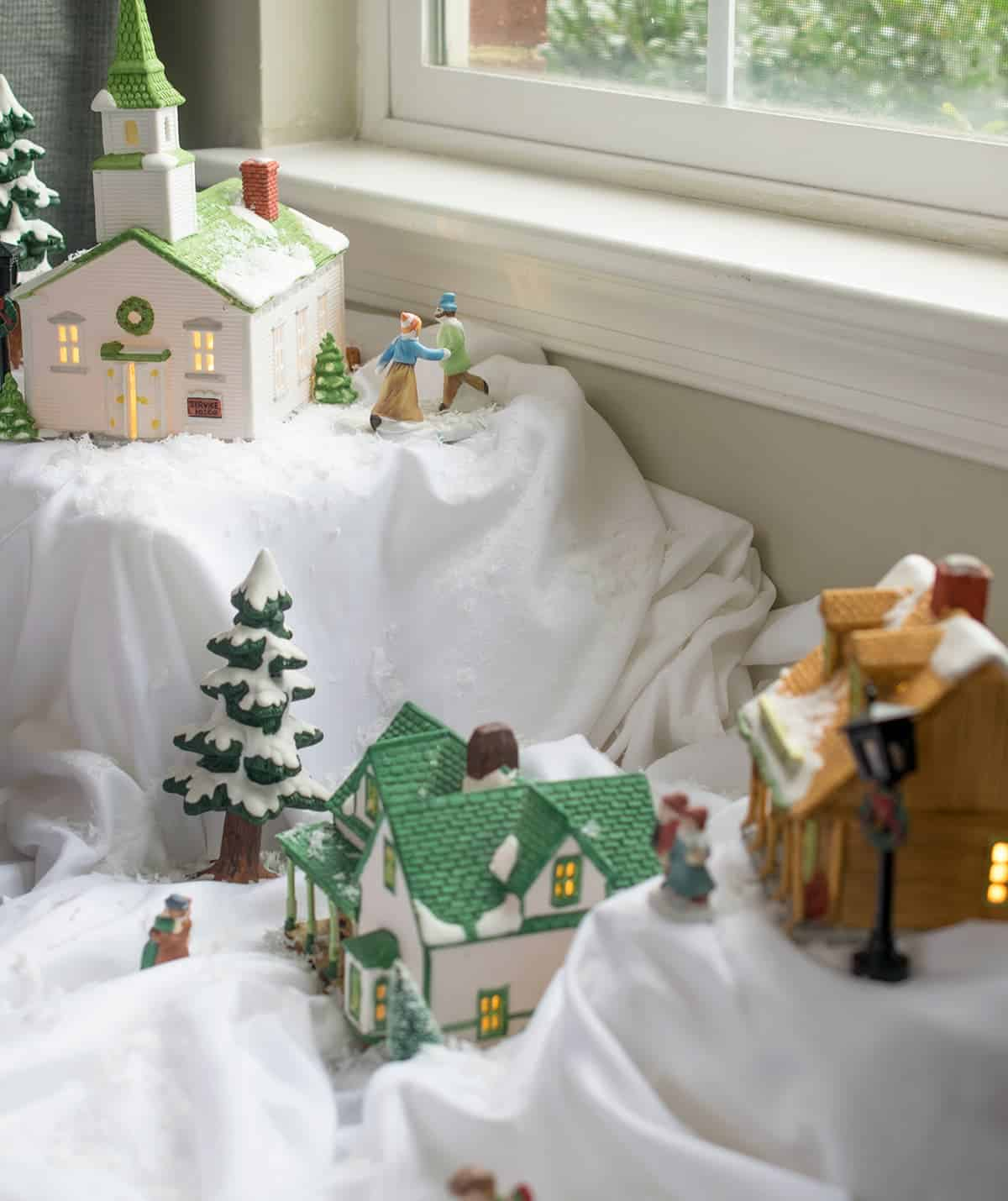 Close up of snowy town village using styrofoam blocks and white bed sheet as props.