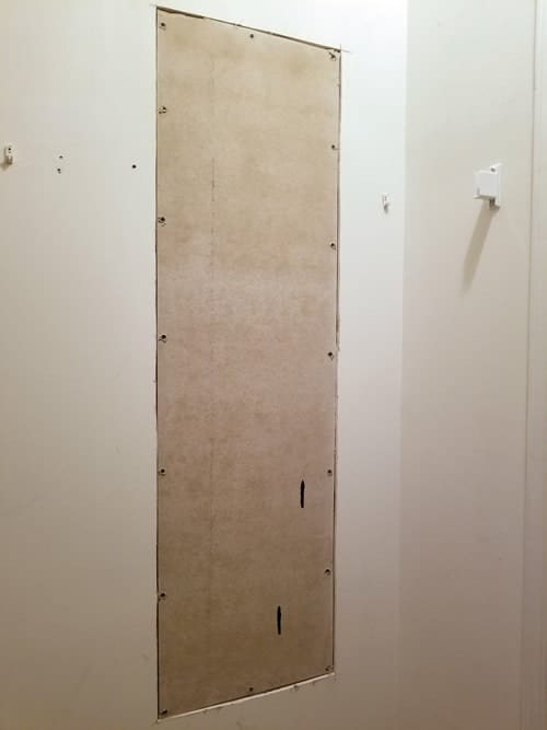 Cement board on dry wall.