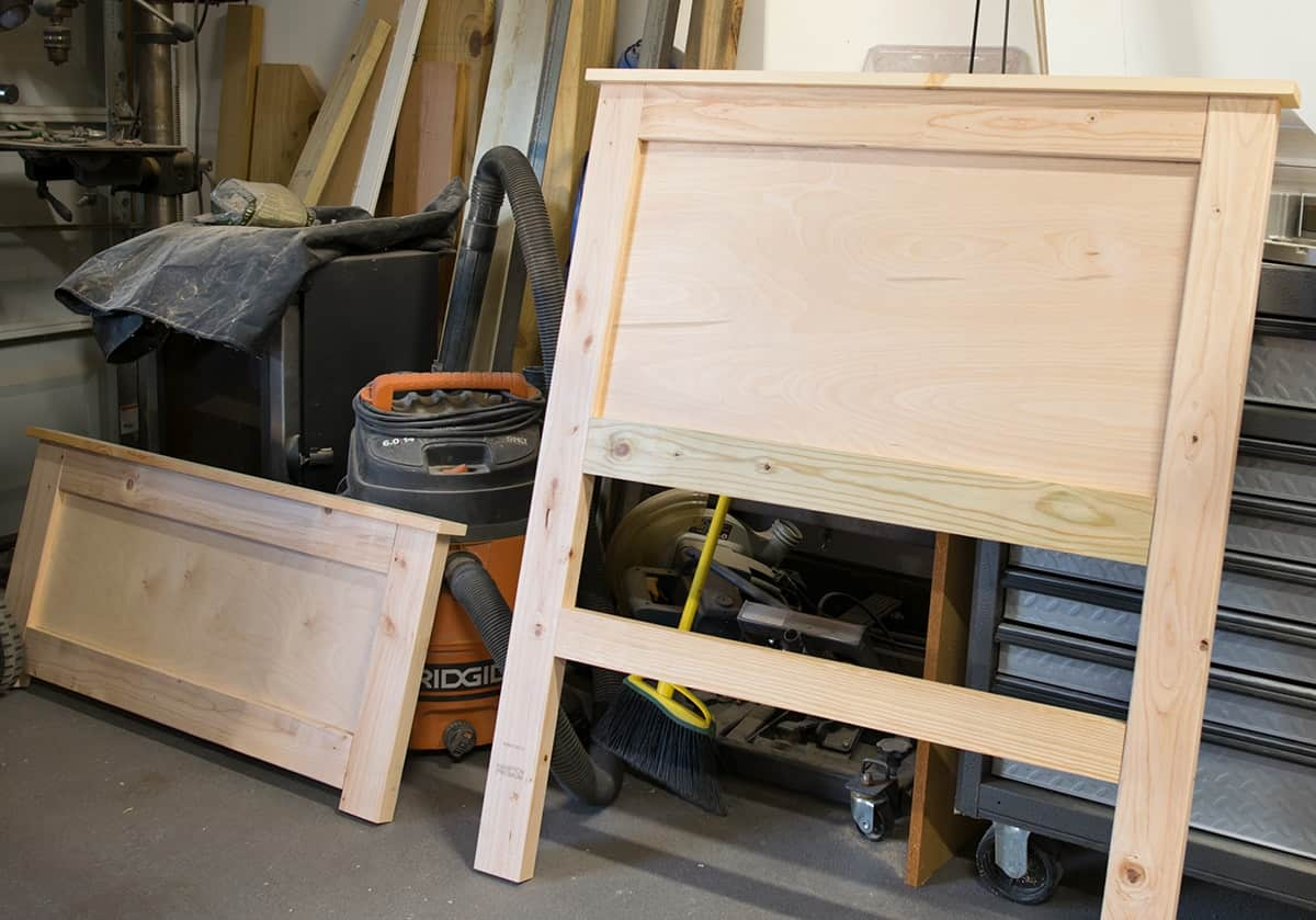 Unfinished Headboard and footboard  in garage setting.