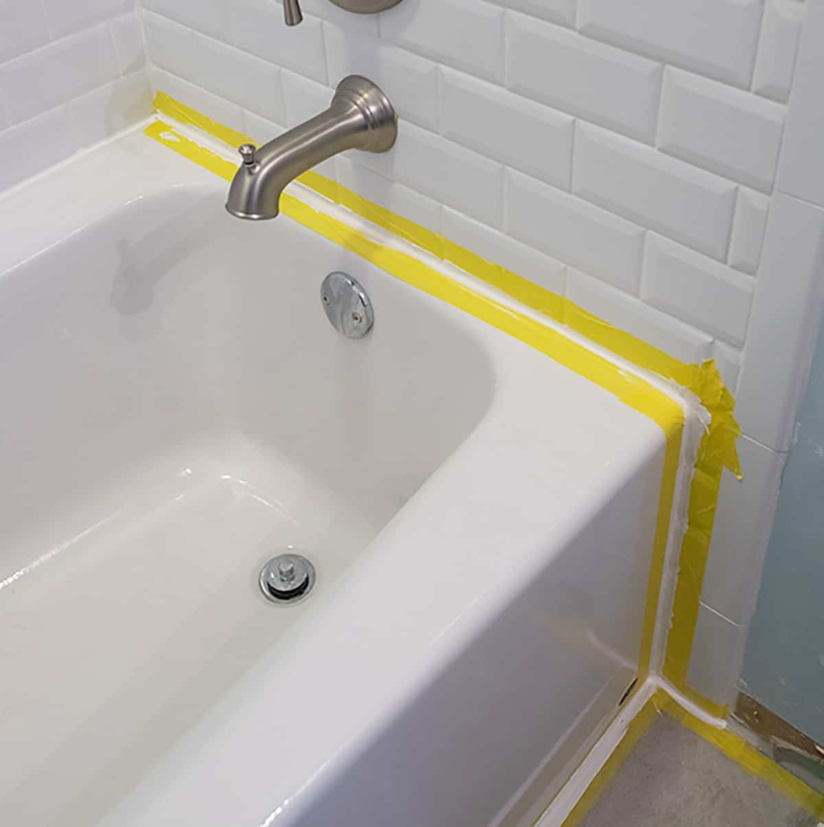 Taping both sides of a tub example for caulking a bathtub