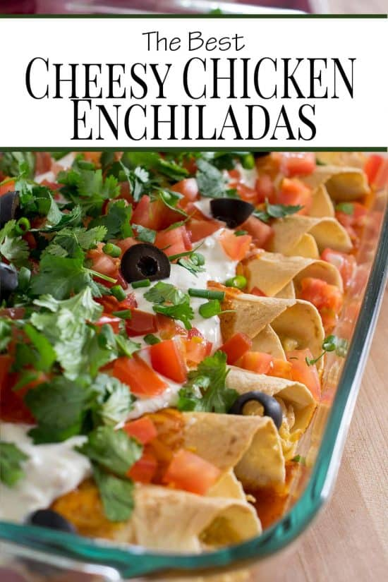 Cheesy chicken enchiladas in a glass dish with toppings.