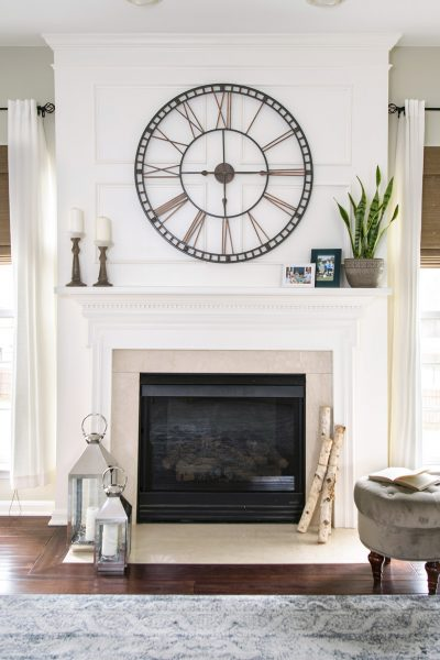Traditional Mantle with Wainscoting Trim and large clock. Living Room Makeover Reveal.