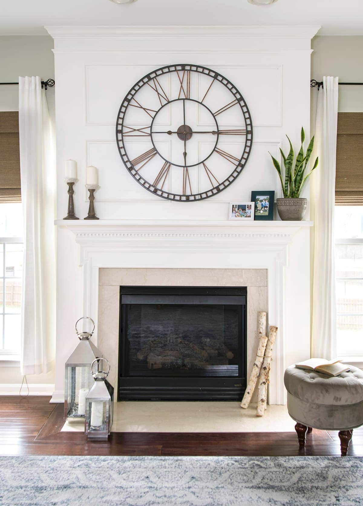 Fireplace and mantel styling. Large modern clock, candlesticks and modern lanterns. Boho global decor accents for traditional living room.