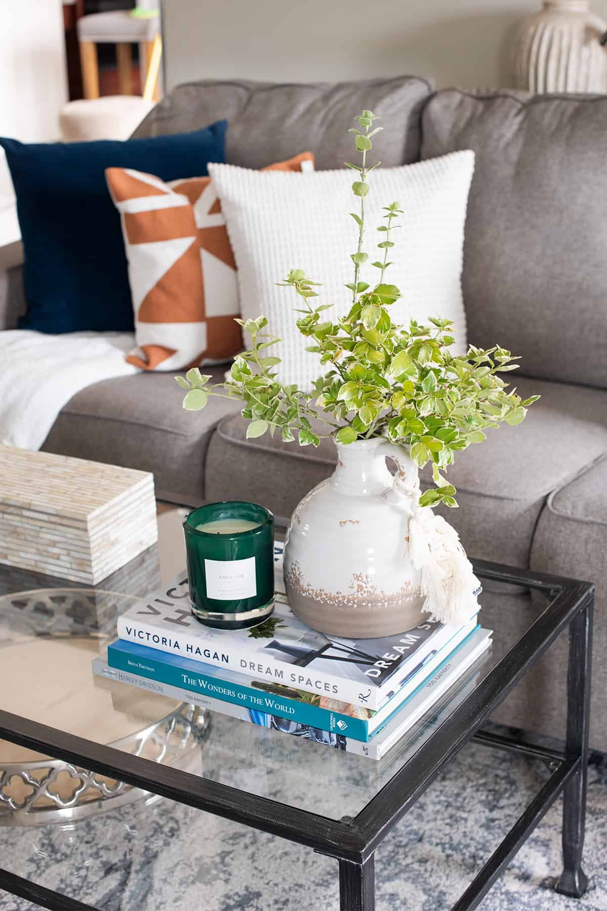 Coffee Table decor with vase, candle, and books.