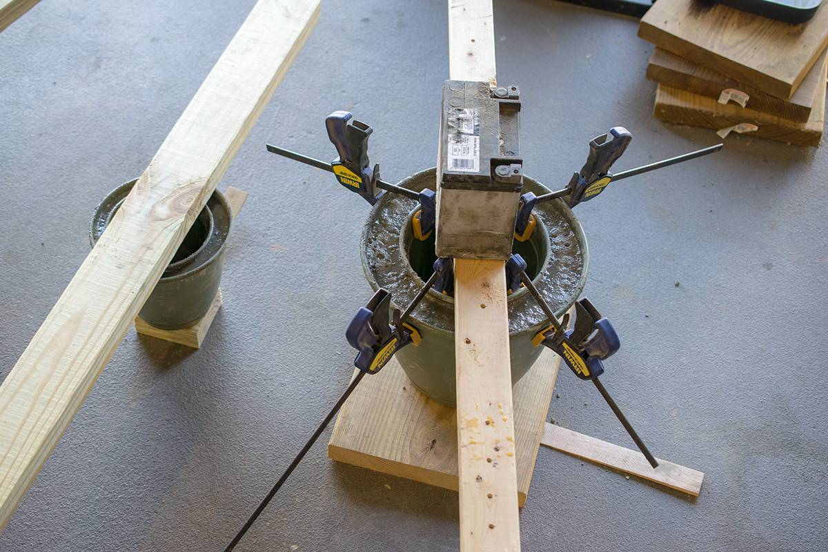 Clamping molds to keep concrete shape from shifting while setting.