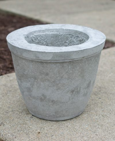 Concrete plant pot waiting to fully dry.