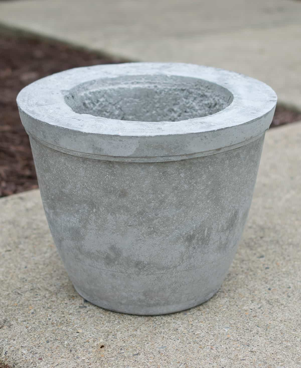 Concrete molded pot before painting.