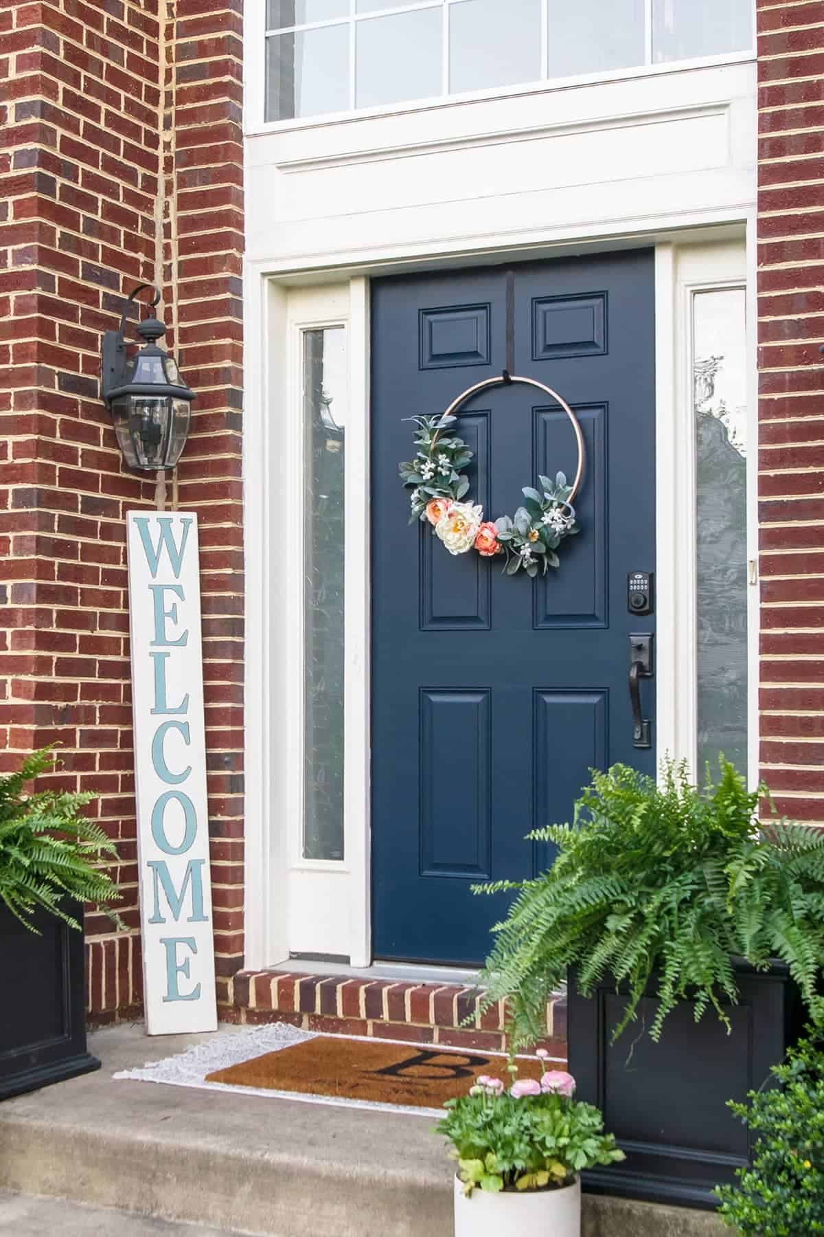 Outdoor Front Door Decorating for brick house including DIY welcome sign.