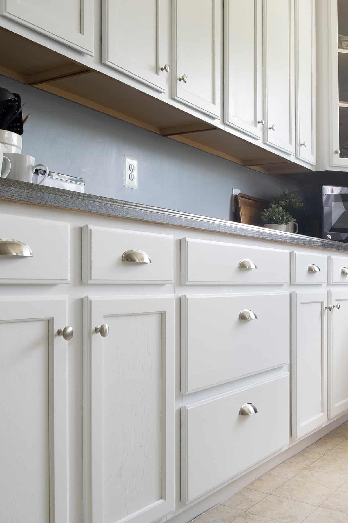 Close up of white painted kitchen cabinets.