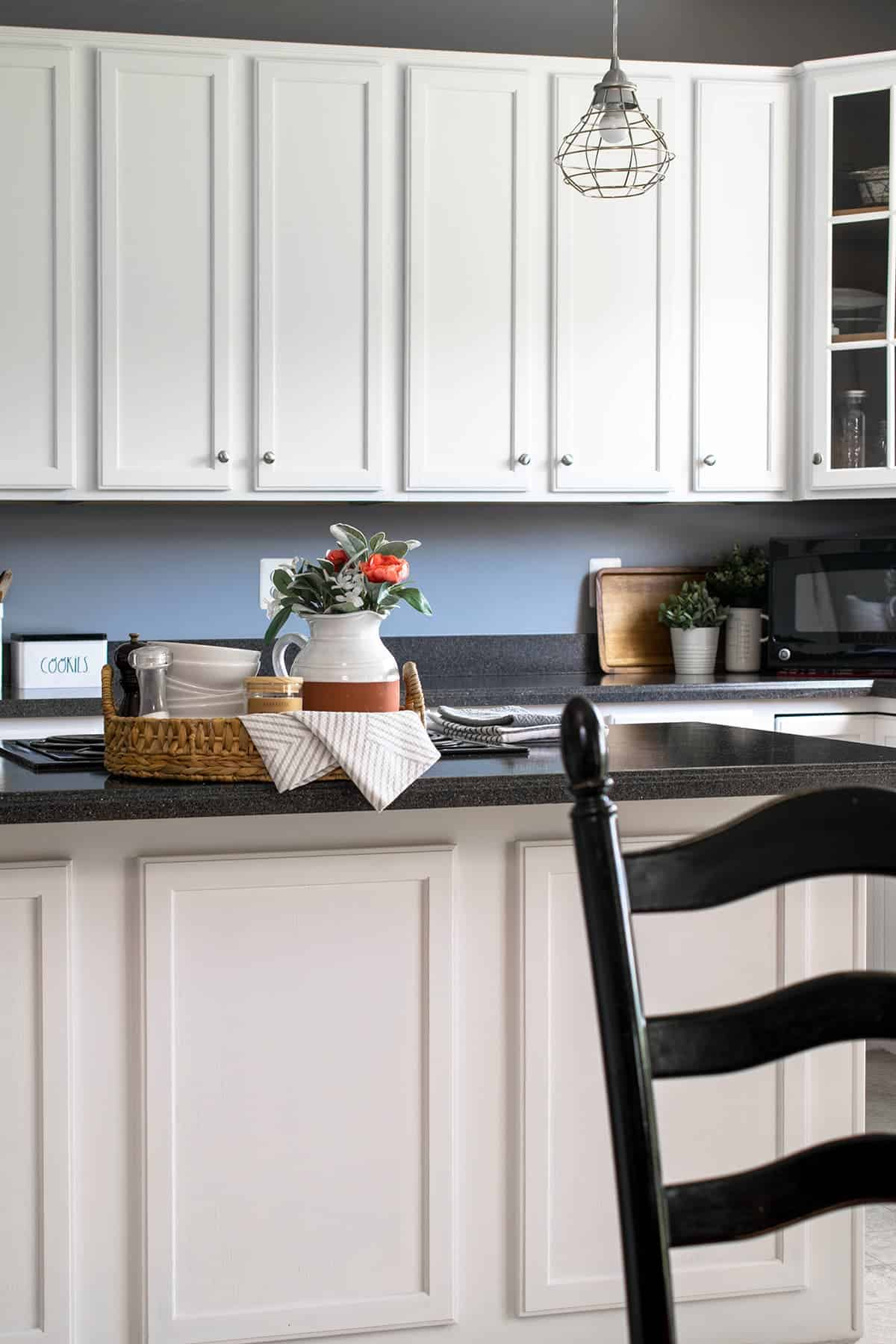 White painted kitchen cabinets with silver hardware.