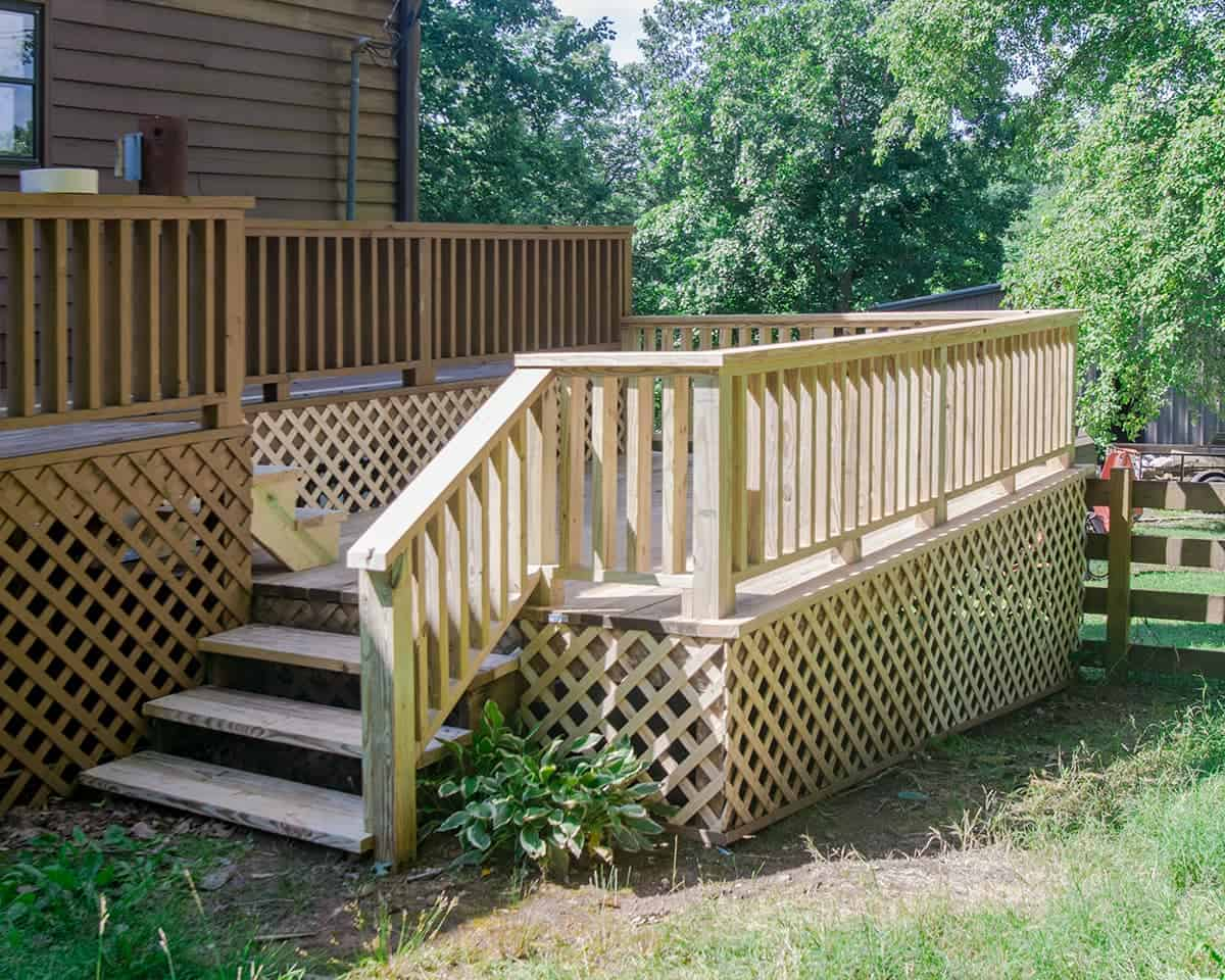 After photo of deck remodel shows new  railing and power washed finish.