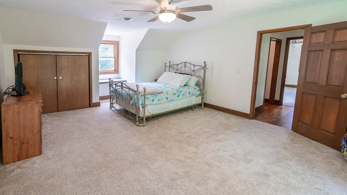 After photo of guest bedroom includes repaired ceiling and walls.