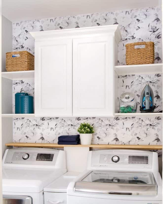 Laundry Room with White Cabinet above shelves