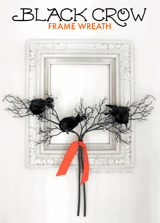 Black crow frame wreath Halloween front porch decor.