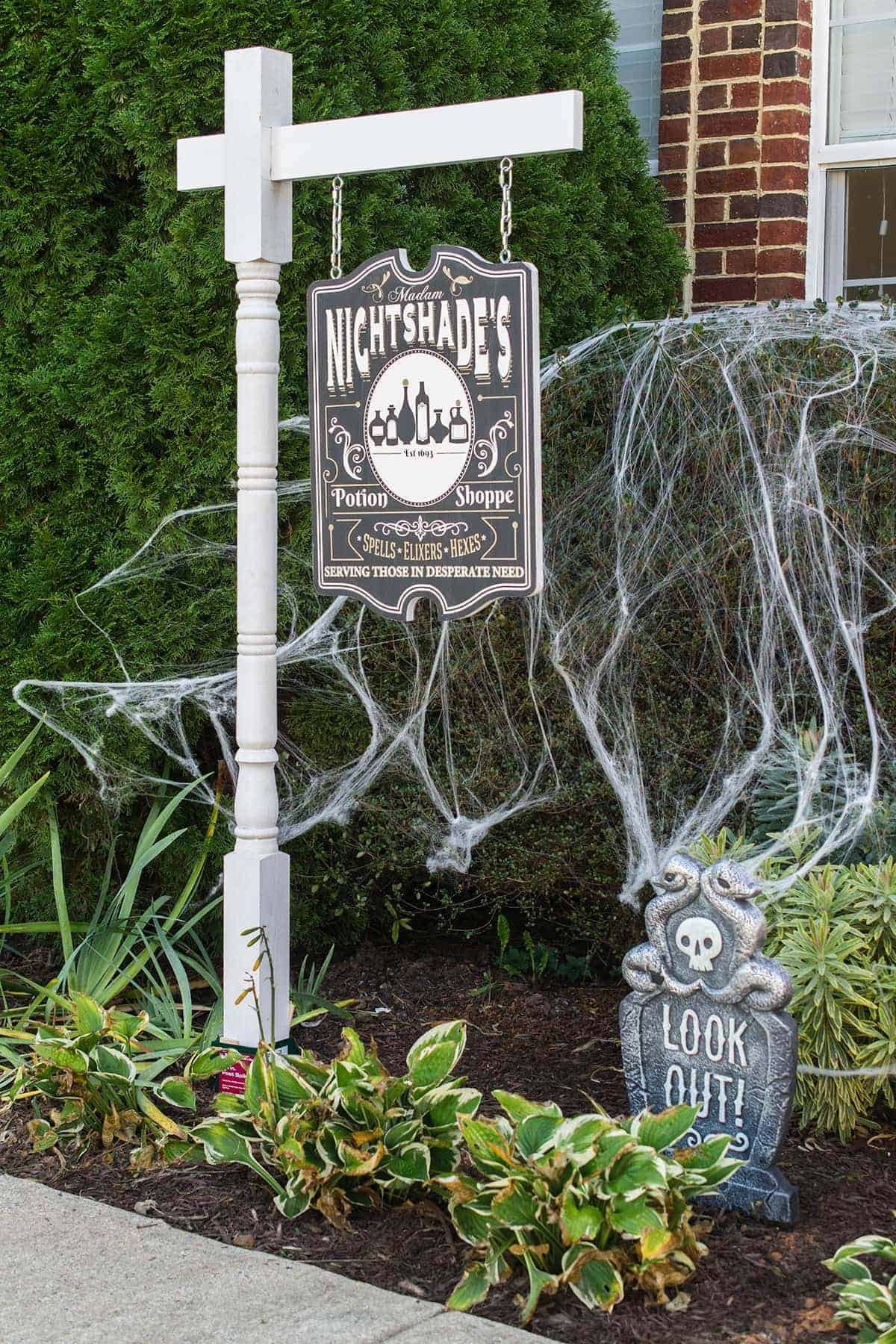 DIY Yard sign with post Halloween theme Potion Shoppe. Spider web background and graveyard.