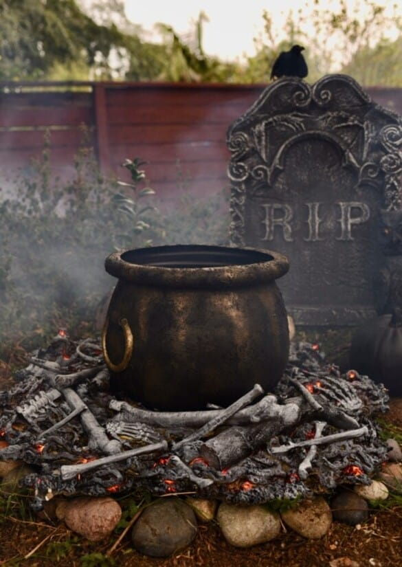 DIY witch's cauldron with realistic fire below.