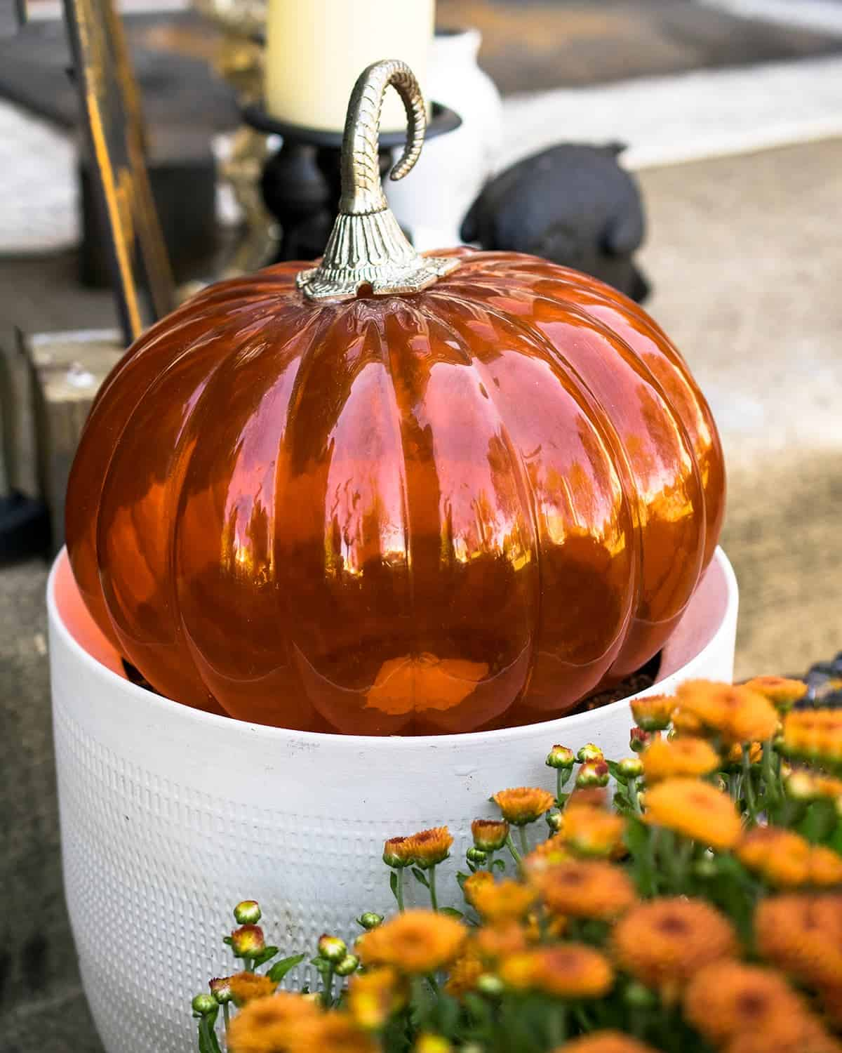 Glass Pumpkin Outdoor Decoration and orange mum.