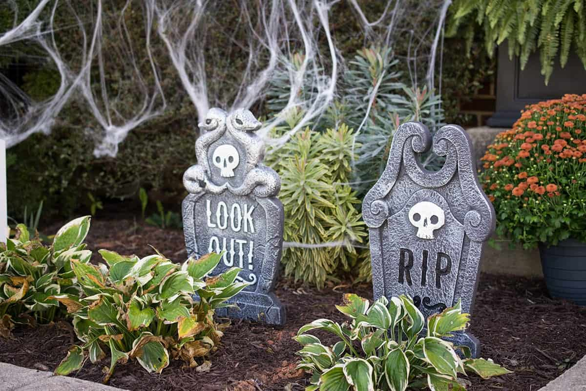 Outdoor Graveyard Decoration Idea with spider webs.