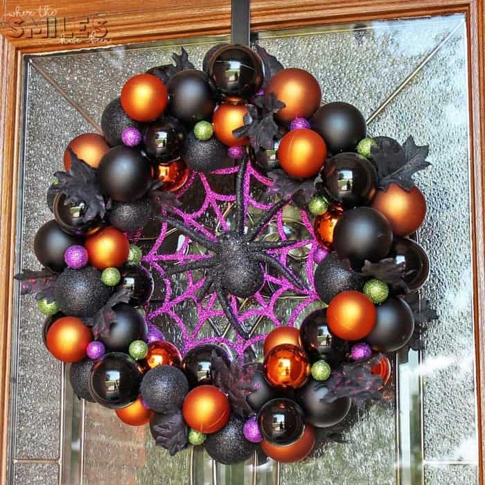 DIY colorful Christmas ball Halloween wreath with spider and spider web.