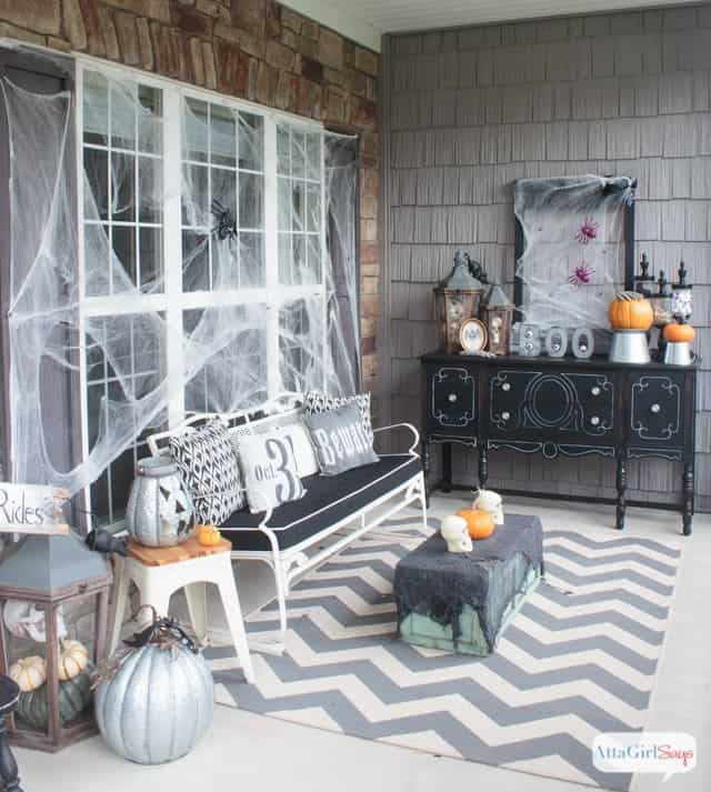 Haunted gothic novel styled front porch decor black, white and silver.