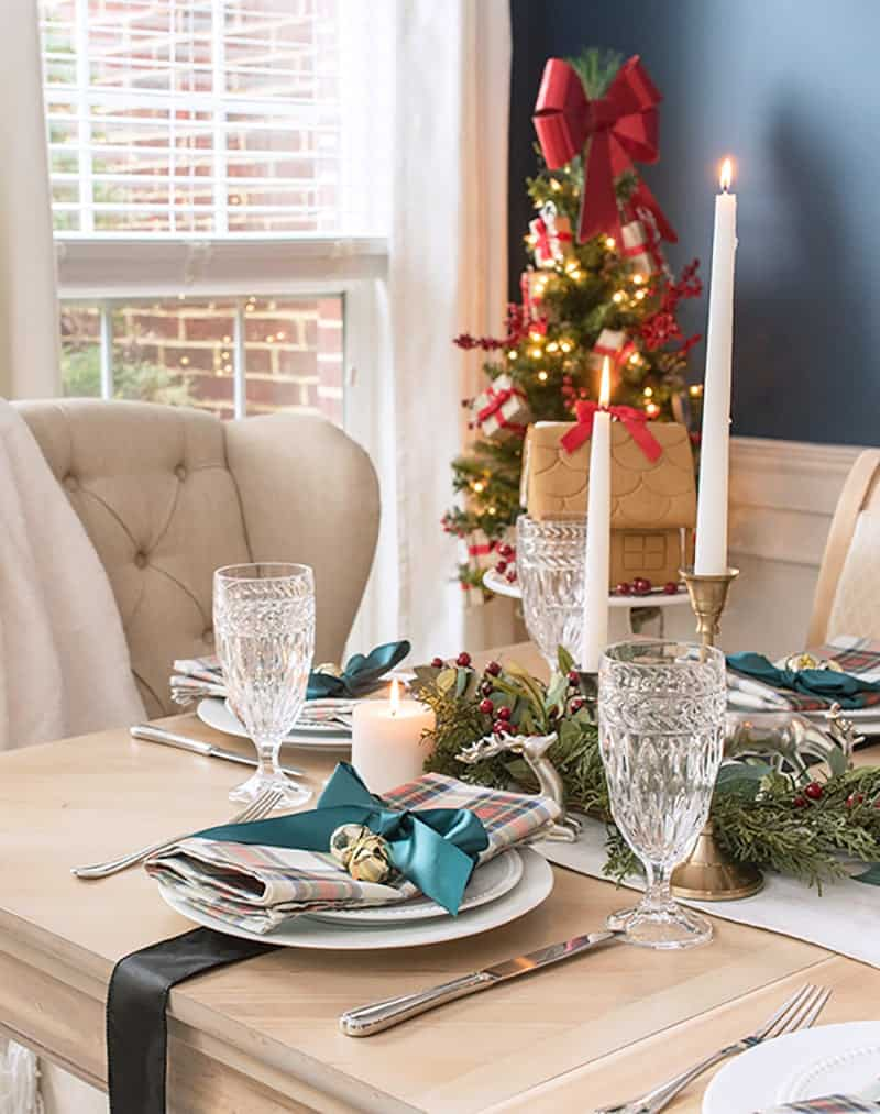 Close up of head of table and place setting. Modern traditional Christmas Plaid Table Settings, Scottish Tartan.