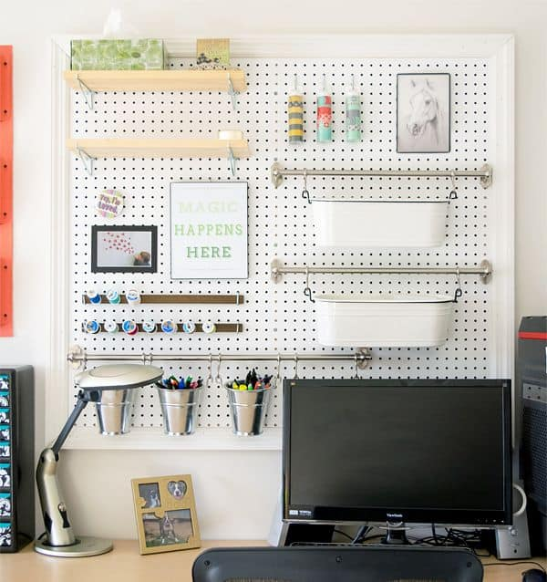 Weekend DIY project. A pegboard organizer in the craft room above the desk workspace.